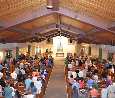 Holy communion and Mass at Notre Dame Catholic Parish in West Denver
